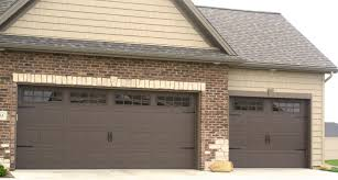 brown carriage style garage door in bloomginton il with gridded