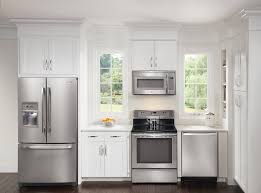 Kitchen Appliance Cabinets by Black Kitchen Cabinets With White Appliances Dmdmagazine Home