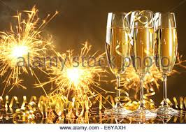new years chagne flutes chagne flutes and fireworks new year concept stock photo