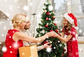 decorating christmas tree smiling family decorating christmas tree stock photo colourbox