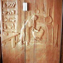 carved cabinet door panels close up of hand carved cabinet door panel birds in an avocado tree