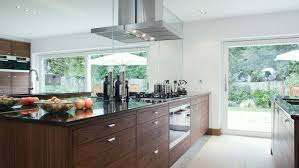 luxury kitchen faucets mirror glass tile kitchen backsplash black quartz countertop wall