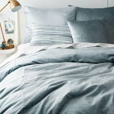 lush and luxurious master bedroom bedding sets displayed by washed