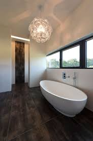 brown wall decoration in modern small bathroom design idea with