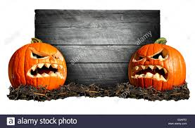 halloween sign with two scary pumpkins in front of an old blank