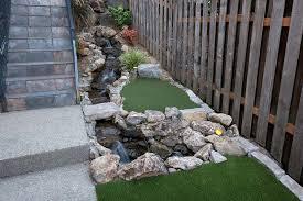 landscape design koi pond putting green u0026 firepit paradise