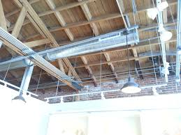 open web truss exposed duct runs rigid conduits supported by a
