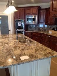 nero marinace gold granite farmhouse sink and countertops