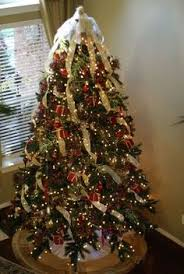 How To Decorate A Christmas Tree With Ribbon Garland I Love The Lit White Tulle Underneath The Christmas Tree Recipe