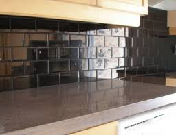 black backsplash in kitchen blue bar cabinets with glossy black backsplash tiles