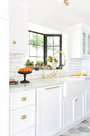 All White Kitchen Cabinets White And Gold Kitchen Features White Cabinets Adorned With