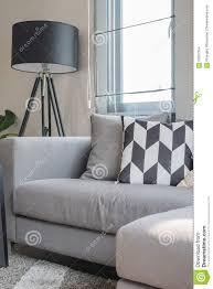 grey sofa modern black and white pillows on modern grey sofa stock photo image
