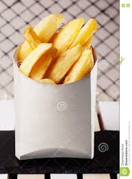 fries slices in a box fast food country potatoes stock photo