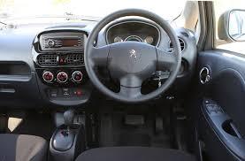 car maker peugeot peugeot ion hatchback review 2011 parkers