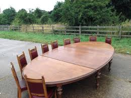 Oak Dining Table Uk Aam21 Oak And Black 5 Piece Set Solid Oak Oval Dining Table And