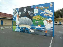 phase 2 and ball wall at john j montgomery elementary creative the upper grade facing side of the hand ball wall tells the story of the history of aviation and space travel from the renaissance to present