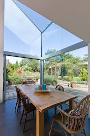 double height dining room with structurally glazed frameless