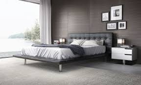High Platform Bed Black Leather Padded Platform Bed Placed On The Black Granite