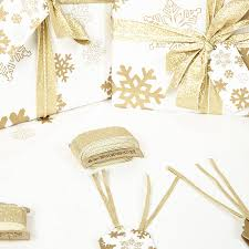 gold snowflakes white wrapping paper by
