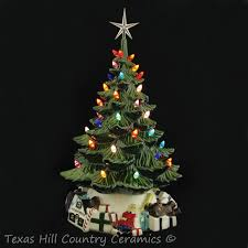 ceramic christmas tree green lighted ceramic christmas tree with santa gift base 18