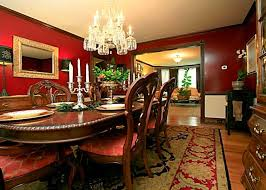 small classic dining room with red wall color schemes and extra