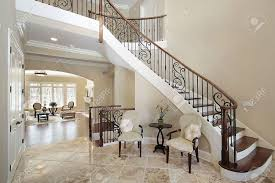 foyer with curved staircase in luxury home stock photo picture