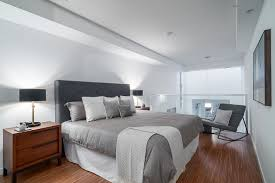 Floor Level Bed Historic Bay Windows Become A Part Of This Polished Vancouver Loft