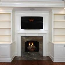 Fireplaces With Bookshelves by Built In Book Cases And Cabinets Around A Gas Fireplace And Tv