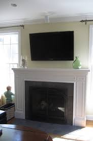 remodelaholic fireplace mantel remodel with white molding