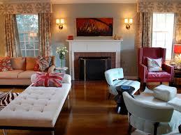 white drapes marble mantel tan sofa round table lamp sheer tongue
