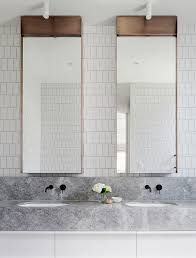 modern bathroom marble countertop white cabinets black faucets