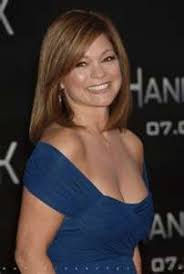 hair styles actresses from hot in cleveland valerie bertinelli long wavy casual hairstyle with layered bangs