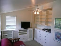 custom built wall units made in tv video game room cabinetry haammss