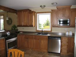 cabinets maple wheatfield with black glaze countertop