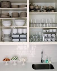 kitchen cabinets rattan vase of greenery with light grey wall