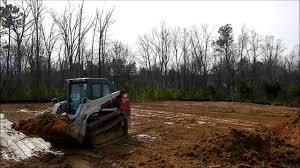 house lots skid steers grading off house lots youtube