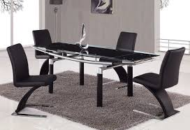 contemporary futuristic black dining table set with four black