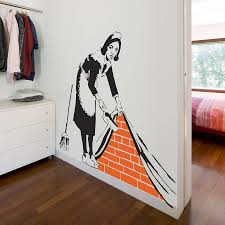 banksy maid wall sticker by ta dah wall art notonthehighstreet com banksy maid wall sticker