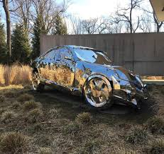 wrecked car a wrecked luxury car built from over 12 000 reflective steel parts