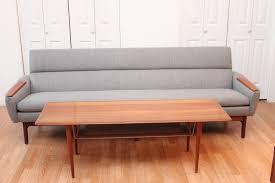 mid century modern danish sofa with teak armrests an orange moon