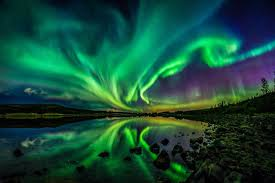 what creates the northern lights northern lights illuminate the night sky as sun unleashes strongest