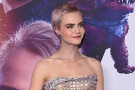 cara delevingne debuts pink hair in her never ending quest to have