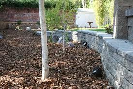 retaining walls make beautiful raised patios