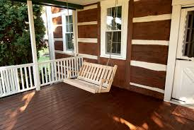exterior traditional porch design with wood siding and oak porch