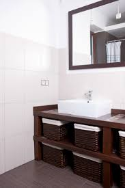 powder room decorating ideas photo gallery stylish tiled wall powder room with white square basin wood framed mirror and basket