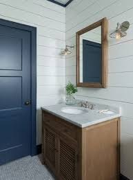 a beautiful gray floating bath vanity fitted with brass knobs and