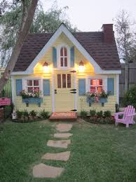 backyard cottage designs love the step stones and flower beds for other playhouse future
