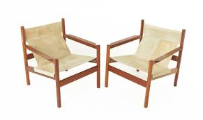 pair of roxinho wood leather sling chairs by michel arnoult at