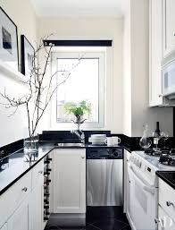 white cabinets with black countertops and backsplash 25 black countertops to inspire your kitchen renovation