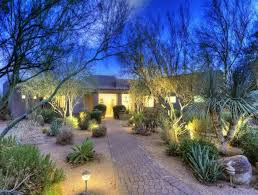 landscaping front yard with river rocks and desert plants long